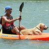 Eric Ellman, executive director of Los Caminos del Rio, and his dog, Buster, on a kayak.