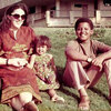 Ann Dunham sits with her father Stanley Dunham and her children, Maya and Barack.