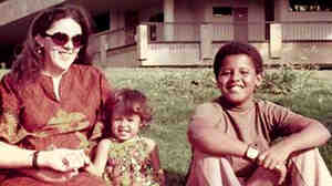 W: Ann Dunham sits with her her children, Maya and Barack.