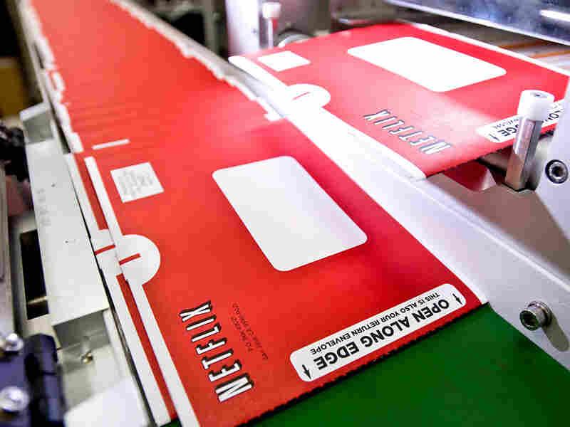 Netflix mailers on a conveyor