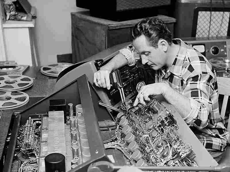 Les Paul tinkers with a control board - 1963