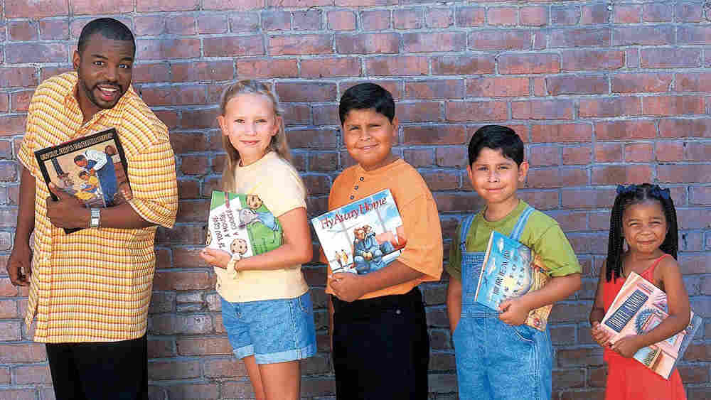'Reading Rainbow' host LeVar Burton with kids holding their favorite books.