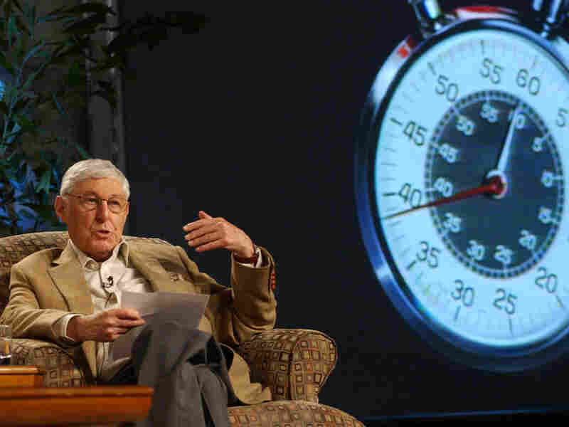 Don Hewitt, pictured in 2004, with the trademark '60 Minutes' stopwatch behind him.