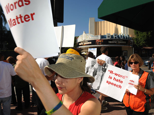 """Protesters demonstrate against <em>Tropic Thunder</em> at its Los Angeles premiere in August 2008. A coalition of disability groups objected to the film because of its repeated use of the word """"retard."""""""