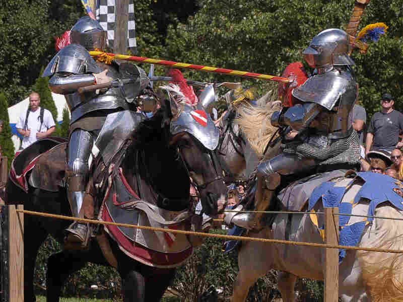 Two jousters in armor atop their horses