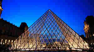 The Louvre pyramid at twilight.