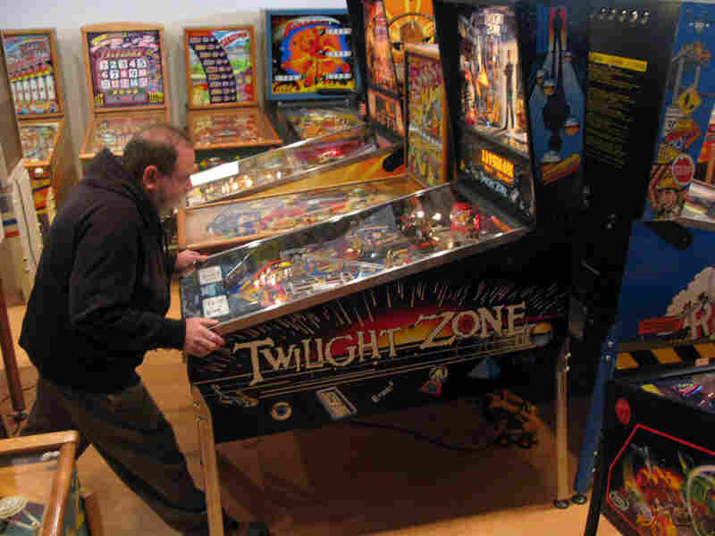 David Silverman plays a game on one of his 800 pinball machines.