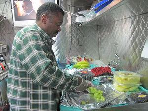 Charlie Scott prepares a plate of fruit.