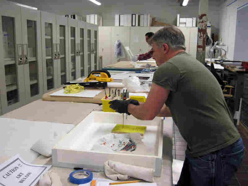 Technicians prepare pieces of 18th-century Meissen porcelain from Germany.