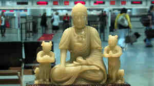 Buddha and his attendants preside over the Virgin Atlantic ticket counter at SFO.