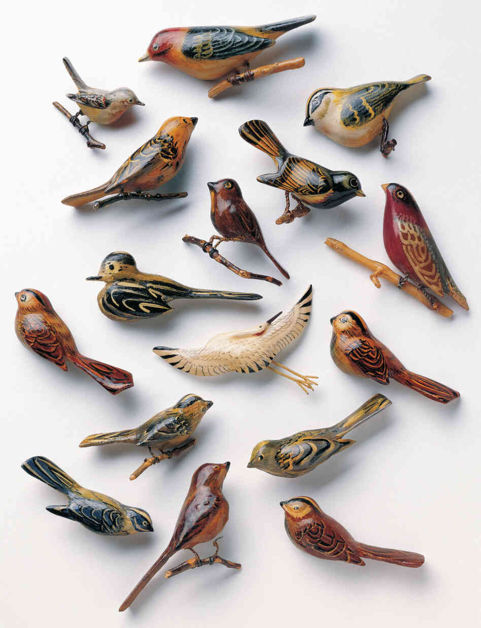 Bird and animal pins made of scrap wood, paint and metal.