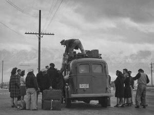 Loading bus, leaving Manzanar for relocation.
