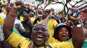South African fans cheer after their team scored against France.