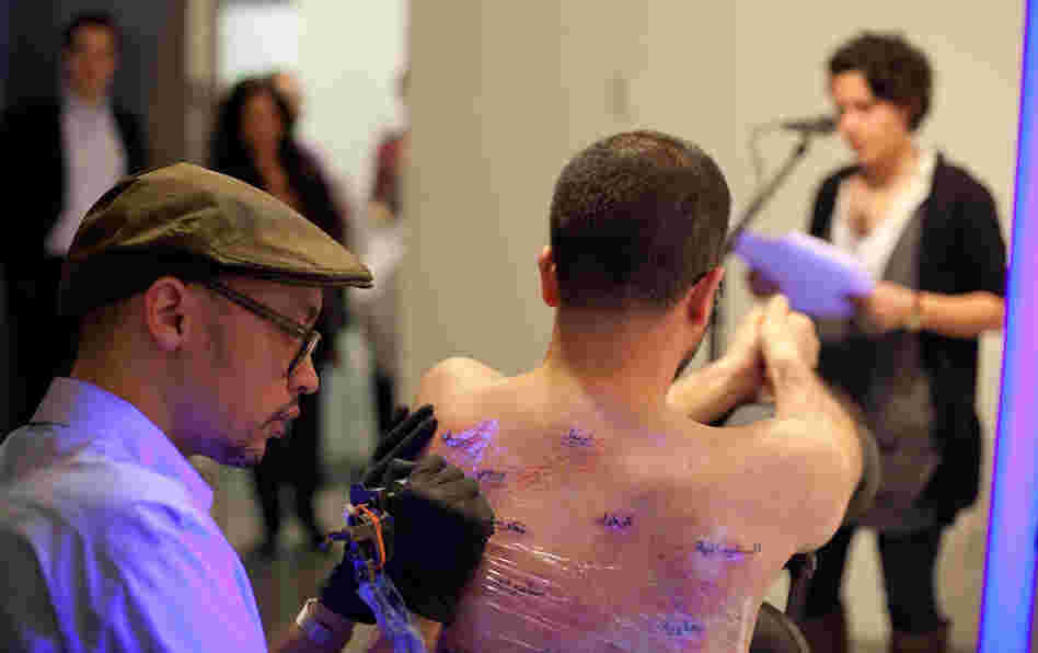 Wafaa Bilal has his back tattooed with dots representing casualties of the Iraq war.