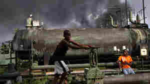 Children playing on a oil flow station in Nigeria