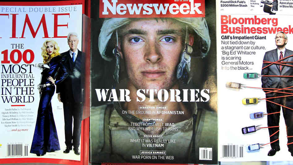 Time and Newsweek on a newsstand