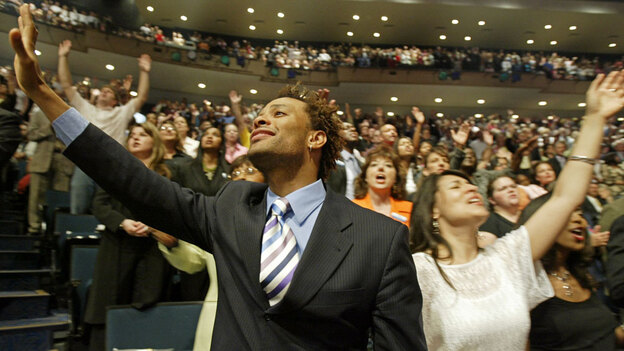 Members of the evangelical Lakewood Church in Houston worship at a