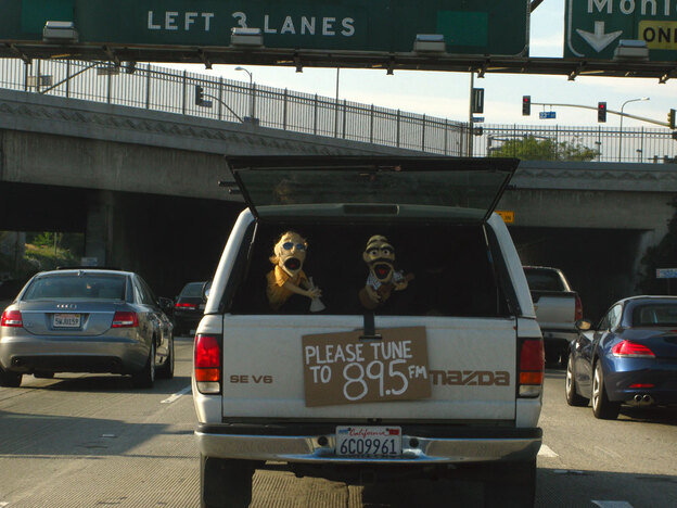 Unlike most L.A. motorists, Kyack and his collaborators actively seek out the most congested sections of the highway. The tailgate sign tells other drivers how to tune in to the show's dialogue.