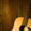 Guitar along wooden planks