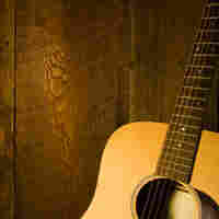 Guitar along wooden planks