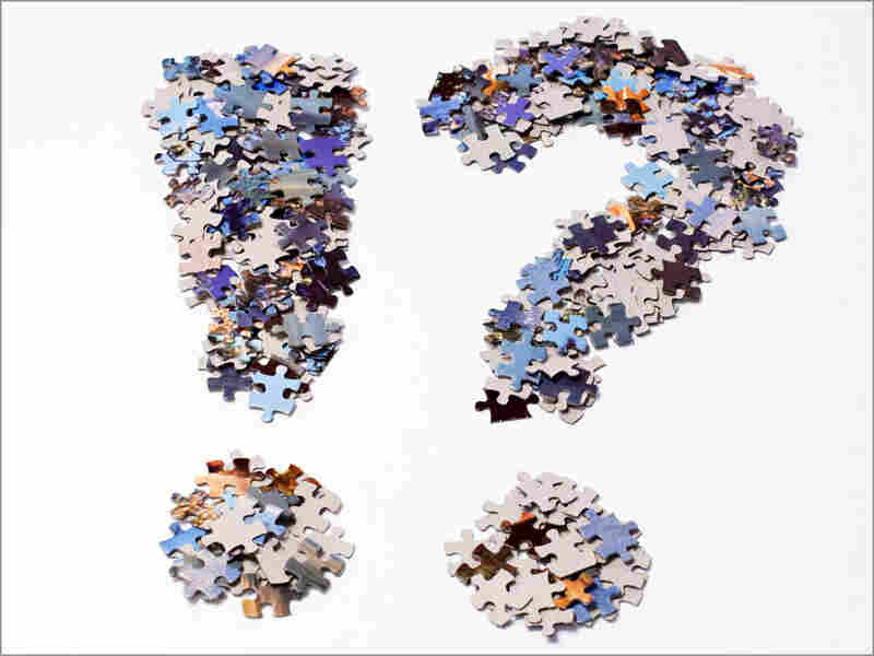 Exclaimation point and question mark made out of puzzle pieces