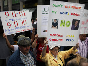 People participate in a rally against a proposed Islamic center and mosque in New York City.