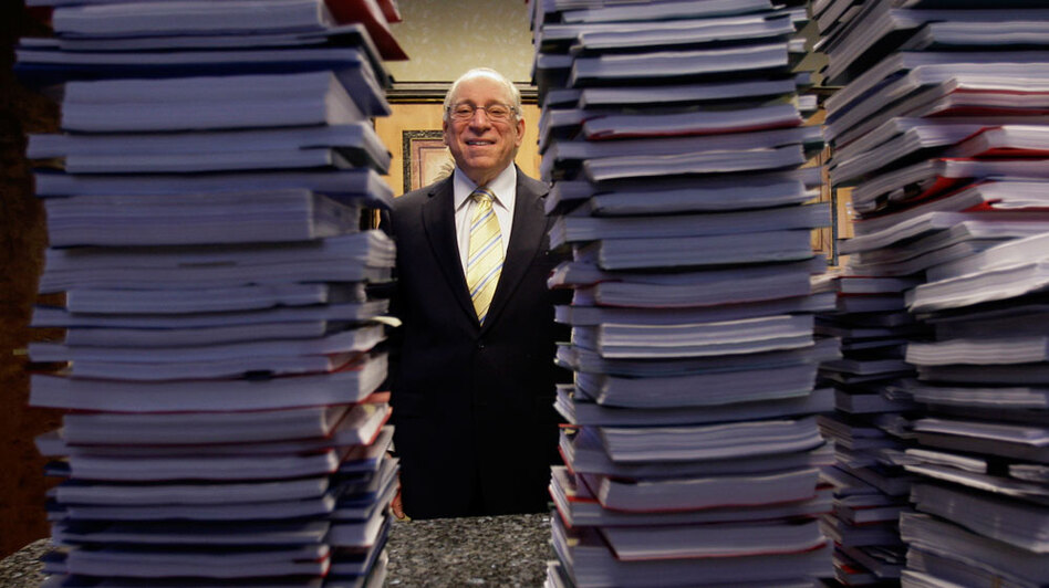 "Lawyer Peter Ticktin of the Ticktin Law Group in South Florida poses behind stacks of  depositions from ""robo-signers"" of foreclosure documents. (AP)"
