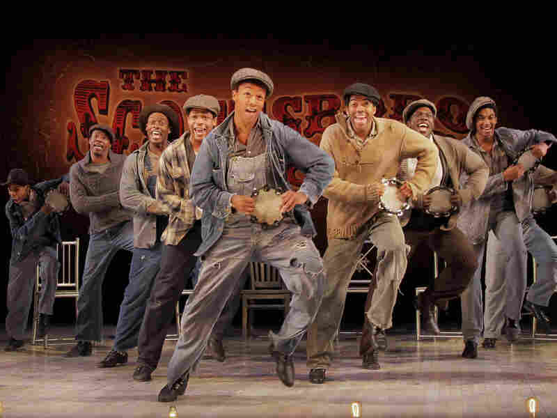 The company of 'The Scottsboro Boys' dancing on stage