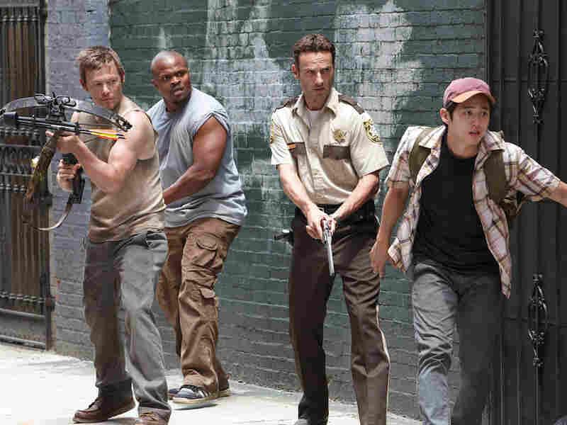 Daryl Dixon (Norman Reedus), T-Dog (Robert Singleton), Rick Grimes (Andrew Lincoln) and Glenn (Steven Yeun)
