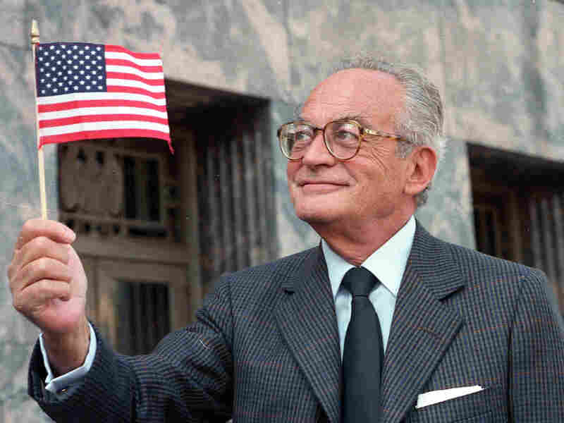 Dino De Laurentiis with an American flag