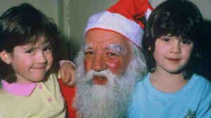 Tegan and Sara with Santa Claus