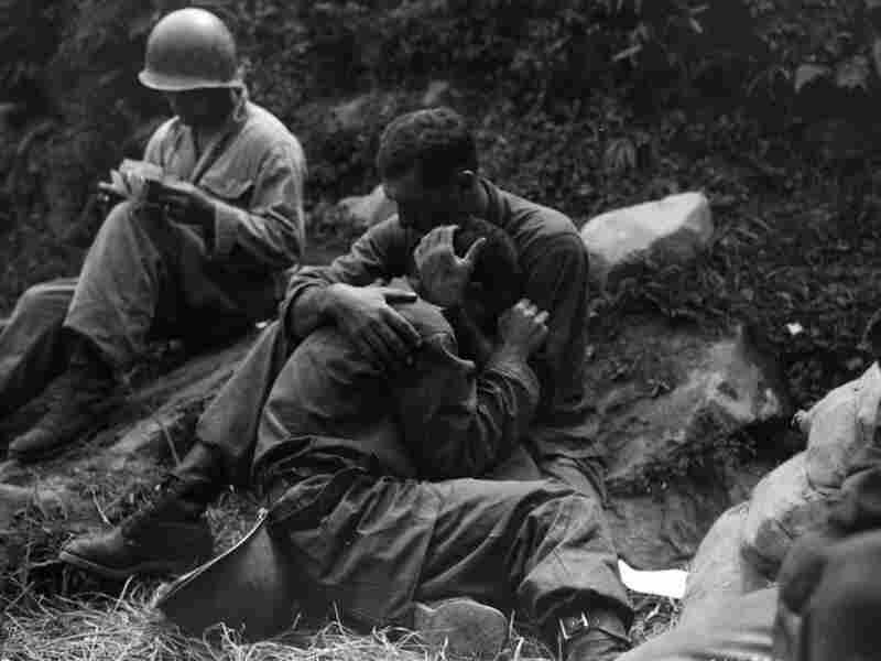Soldiers hugging on battlefield