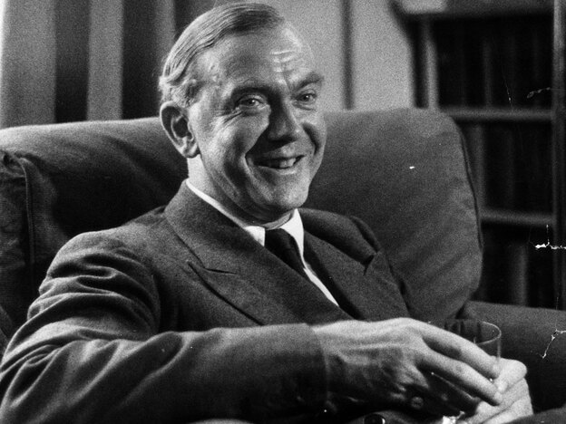 Graham Greene, shown here in 1954, wrote more than 25 novels, including <em>The Power and the Glory</em> and <em>The Quiet American</em>.