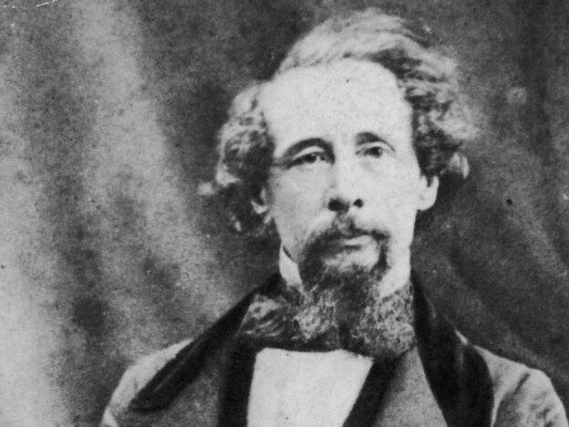 Charles Dickens gives a reading, circa 1860.