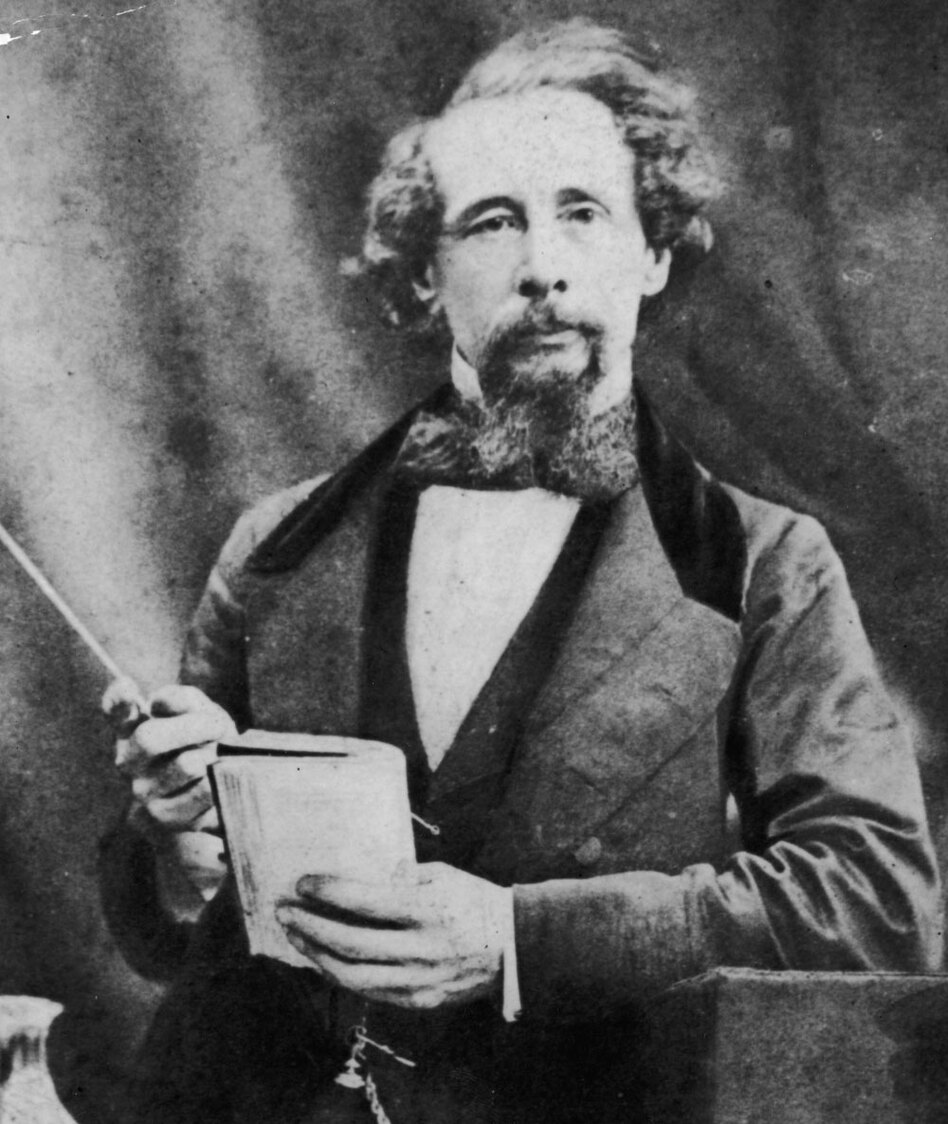 Charles Dickens gives a reading, circa 1860. Dickens regularly made drastic changes to <em>A Christmas Carol </em>when he performed the story.