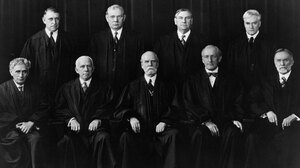 Roosevelt clashed with members of the Supreme Court, including Chief Justice Charles Evans Hughes (center, front row), over his New Deal policies.