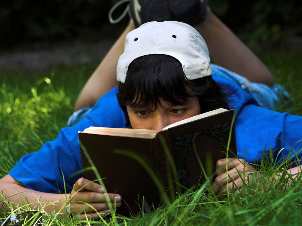 Teen Boy Reading Poetry