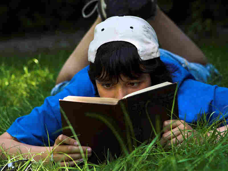 Teen Boy Reading Poetry