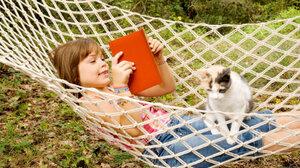 Girl reads in a hammock