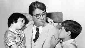 Gregory Peck, Mary Badham and Phillip Alford in 'To Kill A Mockingbird.'