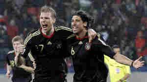 Germany's Sami Khedira (right) celebrates with teammate Per Mertesacker. Gero Breloer/AP