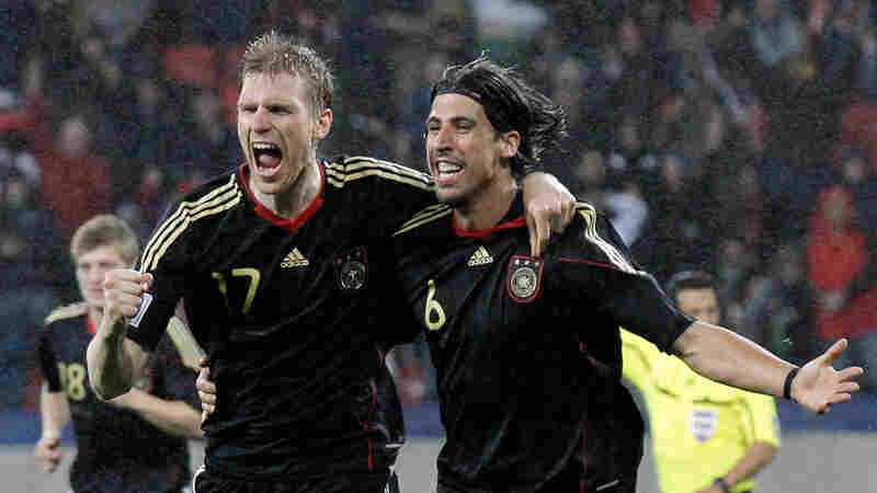 Germany's Sami Khedira (right) celebrates with teammate Per Mertesacker. Gero Breloer/AP