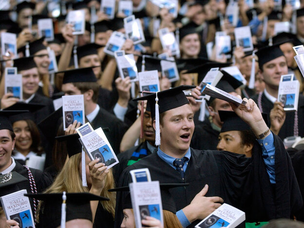 Notre Dame students hold up copies of <em>To Kill a Mockingbird</em> during commencement ceremonies in May 2006 -- during which the university awarded Harper Lee an honorary degree.