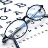 Eyeglasses sitting on eyechart