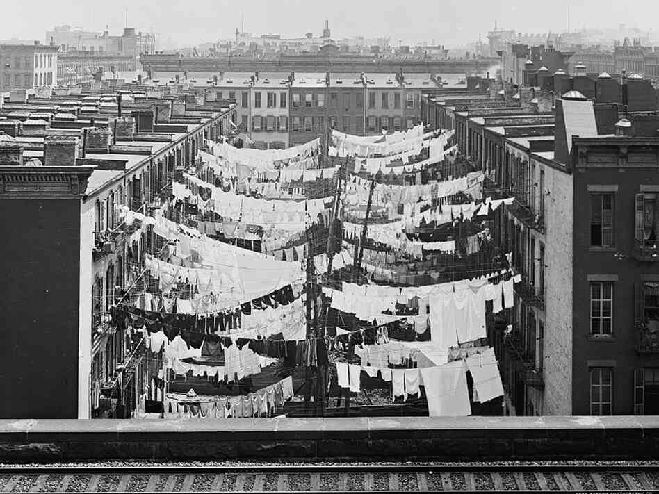The yard of a tenement at Park Avene and 107th Street, circa 1900.