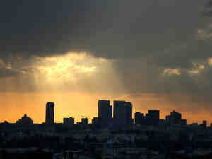 Sunlight filters through clouds over West Hollywood, Calif.