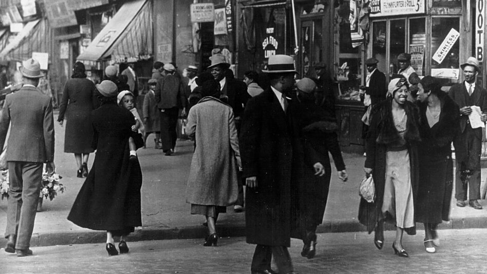 In the 1920s, Harlem's African-American population exploded — with nearly 200,000 African Americans inhabiting a neighborhood where there had been virtually no blacks 15 years earlier. Above, a Harlem street in 1942. (Getty Images)