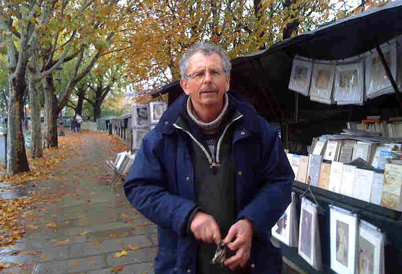 Bouquiniste Jean-Pierre Matthias stands beside his stalls on the River Seine in Paris