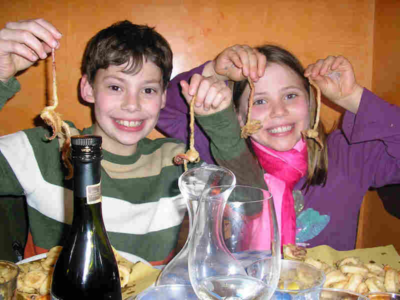 Nick and Adriana Marchetti enjoy fried calamari at a restaurant in Italy