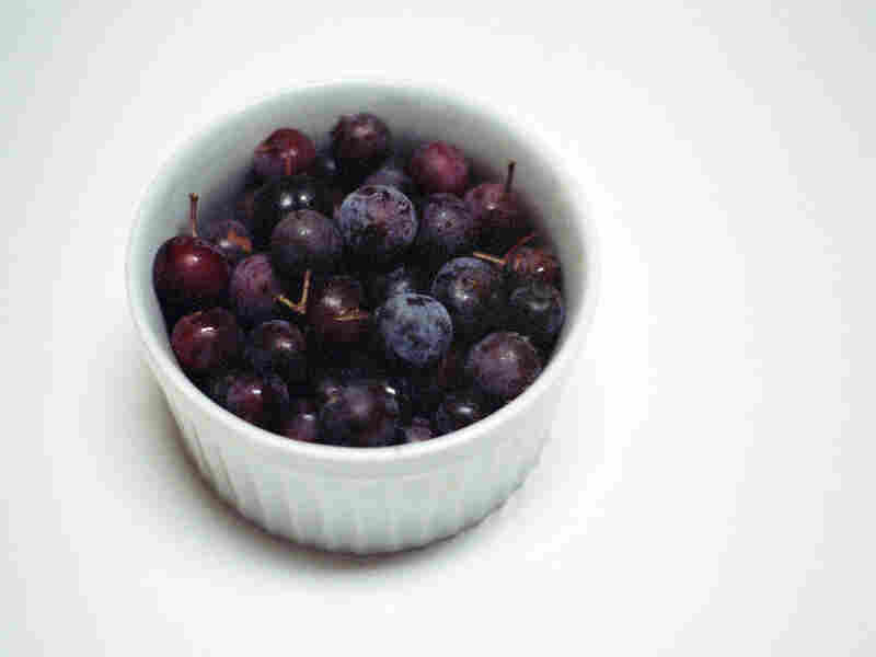 Beach plums in a white ramekin